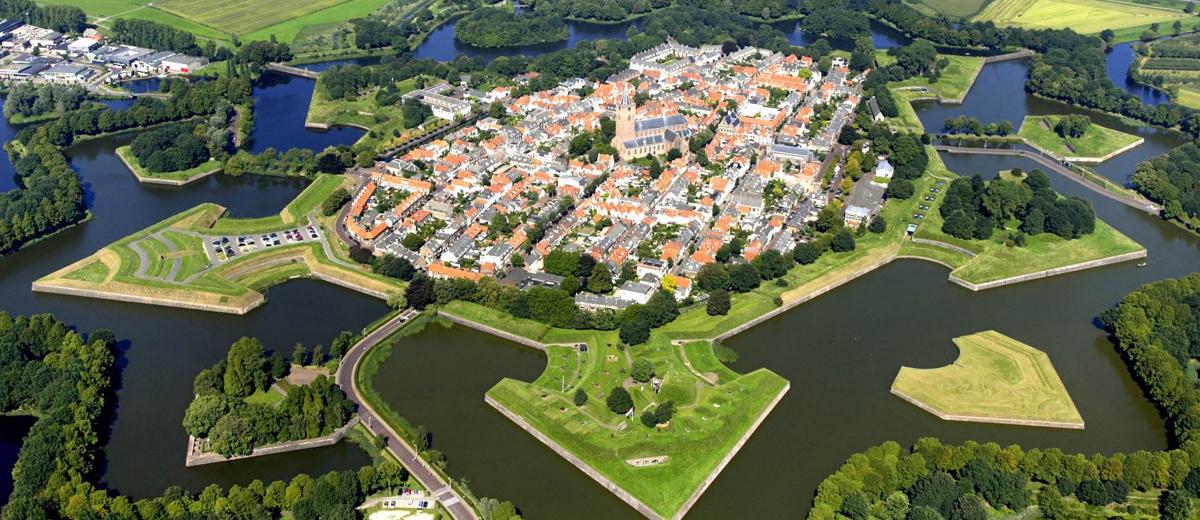 SUP route door vestingstad Naarden (8.5 km) - Happy Supper